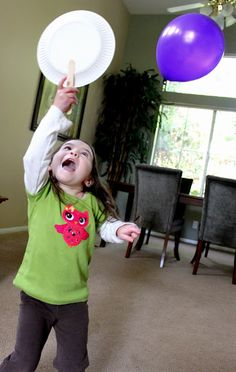 Balloon badminton...fun activity to play....what kid doesn't like to play with balloons?  This would be great to play on a rainy day too.
