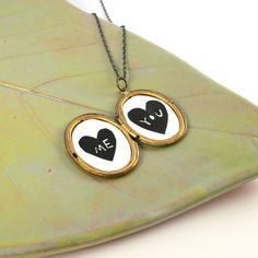 Paper Cut Me and You Heart Silhouettes in a Vintage Locket on Etsy, $28.00