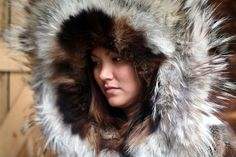 An Athabascan girl models the traditional parka with a 'sunshine' ruff.