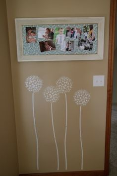 this is a cute DIY clothespin picture frame - I like the wall decals below, too!