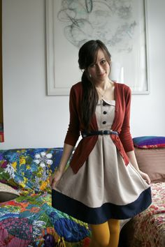 belted dress and cardigan with brightly coloured tights.  I'd wear these kind of outfits everyday