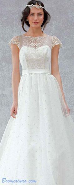 Gorgeous ethereal ball gown bridal gown with symmetrical folk-style embellishment on the bodice - read about woodland weddings, the coolest boho wedding trend - article - http://www.boomerinas.com/2014/10/17/woodland-wedding-dresses-ideas-for-wedding-2-or-3-or-4-or-whatever/