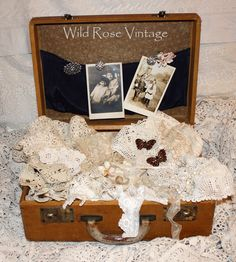 Wild Rose Vintage: Beat up old suitcase full of pretty treasures!
