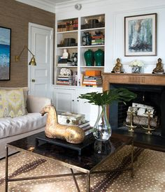 casual, sophisticated, eclectic - grasscloth walls, spotted rug, mix beige and black