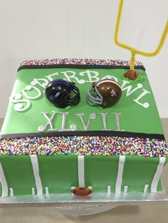 Superbowl vanilla flavored cake sweet covered in fondant.