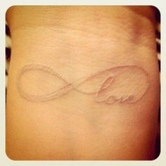 white infinity tattoo