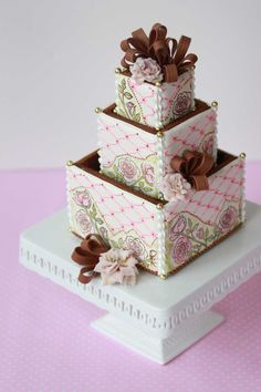 Another 3-D cookie wedding cake box by Julia M. Usher. 100 percent edible, from the box to the ribbons and roses on top!