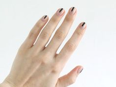 15 Ways to Make Black Polish Work for You - This dramatic shade can be perfectly pretty (not scary) if you use it right.