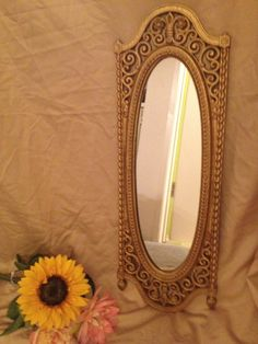 Vintage ornate gold painted mirror. $26.00, via Etsy. www.etsy.com/shop/shabbyciccalifinds mirrors, vintag ornat, vintage, etsi, paint mirror, ornat gold, 2600, gold paint