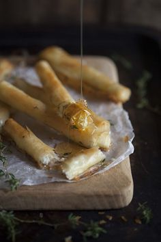 350 F (conversions: 1/4 cup butter + 1/2 cup goat cheese) || baked goats cheese cigars with honey and thyme