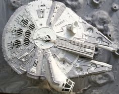 Millenium Falcon Cake - Chocolate cake with swiss meringue buttercream covered with fondant and gumpaste pieces.