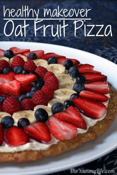 Healthy Fruit Pizza with a whole grain, oatmeal cookie crust and yogurt frosting. It's nutritious enough for breakfast & fancy enough for dessert.