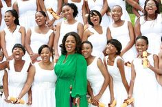 Oprah celebrates with 72 young girls who became the first graduating class from Oprah Winfrey Leadership Academy, founded in 2007, in Henley on Klip, South Africa.