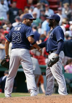 Carlos Pena congratulates Fenando Rodney on the Rays win against the Red Sox Game 10 04/16/12