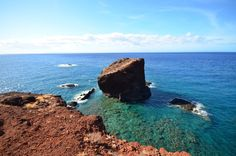 Rising from the sea just between Hulopoe and Manele bays on Lanai is iconic Puu Pehe, or Sweetheart Rock. Learn about the legend behind the picturesque natural landmark at: http://www.gohawaii.com/lanai/regions-neighborhoods/south-lanai/puu-pehe