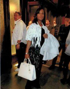 "Coat: ""Escada"" 'Cathy' White/Black Applique Pattern, Spap Front. Purse: ""Prada"" White Hard Body, 2 Handle Tote. Watch: ""Movado"" Silver w/ Diamonds"