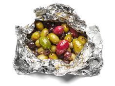 Spicy Olives on the Grill:  Toss 1 cup olives, 1/2 teaspoon red pepper flakes and 1 minced garlic clove on a sheet of foil. Form a packet. Grill over medium-high heat, turning often, 15 minutes.
