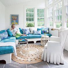 10 Beautiful Beach Cottages | Cheery Sunroom | CoastalLiving.com