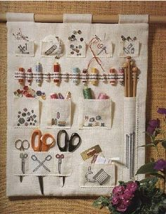 Make this for knitting supplies - needles, scissors, pins, safety pins.  Make it so you can take it off the wall and roll it up to make it portable.