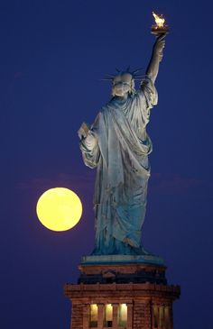 liberty statue watching the moon