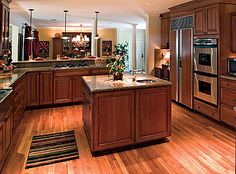 kitchens with darker floors than cabinets   Matching Cabinetry and Wood Floor Color