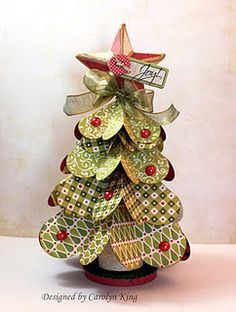 Paper heart Christmas tree - this would make a lovely table decoration for the family christmas meal!