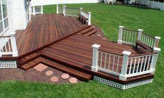 adding a deck, backyard ideas, dark stained deck, landscaping back deck, diy back deck, dark deck stain, diy decks and patios, deck seating diy, backyard designs
