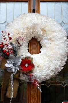 Coffee Filter Wreath. Hot glue about 400 coffee filters to a wreath form, then hot glue on the embellishments as needed. Spray paint the wreath for different holiday seasons. Really cool Idea!