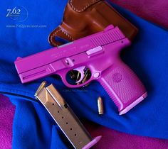 S Sigma SW40VE .40 S pistol with magenta slide and frame and lighter pink accents.