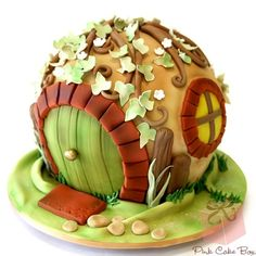 IT'S A HOBBIT HOLE CAKE!!! OM NOM NOM NOM *CRYING* themed birthday parties, pink cakes, the hobbit, hobbit home, fairy houses, hobbit houses, cake boxes, cake recipes, birthday cakes