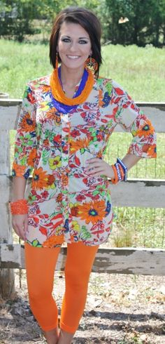 Boogie Wonderland Orange Flower Tunic  Price: $42.95 - $46.95  Size: Small, Medium, Large, XL, 1XL, 2XL  http://www.giddyupglamouronline.com/catalog.php?item=5828