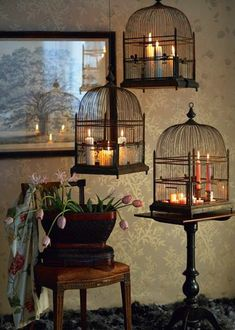 Birdcages used as lanterns.  Beautiful.