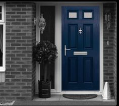 blue front door with dark gray brick and white trim.   AND its TARDIS blue! Gorgeous! My daughter would love this!