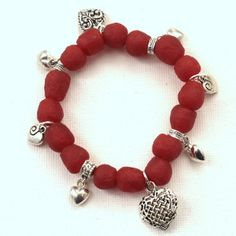 Cranberry Red Elastic Stretch Bracelet. The cranberry red beads make this homemade bracelet the perfect colors for Valentine's Day. Learn how to customize your DIY bracelet with adorable charms, like hearts or stars.