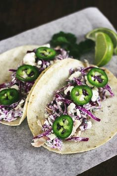 Chicken and cabbage tacos with cilantro cream.