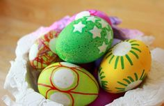 decorate easter eggs with stickers and sharpies
