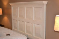 Headboard made from a door with some molding added to the top.