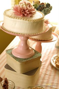this lady made the cake stands by spraying some candle holders and plates from the thrift store candy pink and gluing them together.