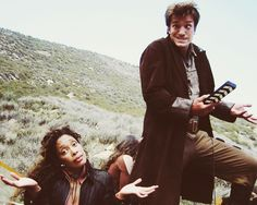 Nathan Fillion and Gina Torres goofing off on the set of Firefly <3