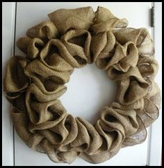 "Burlap Wreath - i once found a tutorial on how to make this but cant find it again.  I think wire wreath, wire to secure burlap and ""fluff"" burlap inbetween where the wires secure it.  Make two rings of burlap (one on the inside and one of the outside)"