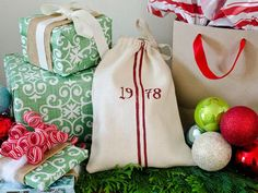 "Instead of a traditional Christmas stocking, try making these fun, vintage grain sack inspired ""stocking sacks."""