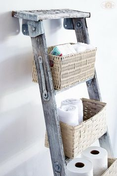 DIY basket ladder storage: Make use of vertical space and add baskets to on old ladder. 20 Creative Ladder Ideas for Home Decoration, http://hative.com/creative-ladder-ideas-for-home-decoration/,