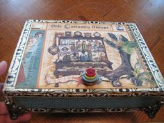 Altered a cigar box!  What a cool box!  stacked buttons for the handle...like!