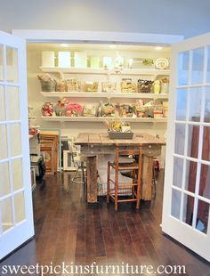This craft room is absolutely stunning.  Be sure to click through to the blog; there are a lot more photos that show details and other parts of this amazing room