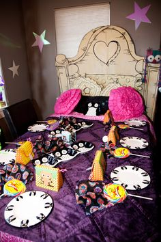 its a TABLE FOR PAJAM THEME PARTY. Head Board made out of an old refrigerator box, sheets and pillows purchased on sale at TJ Max, later were used on the bed - Fun Theme with everyone arriving in pajamas for the party - Kids and adults