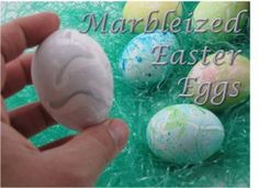 DIY - Marbleized Easter Eggs - shows how to make marbleized eggs with just food coloring, vinegar, cooking oil, & water