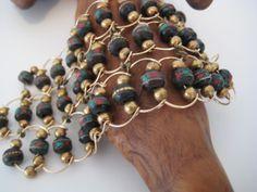 Tibetan dark bone cuff w coral, turquoise, copper, and brass inlay