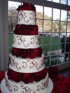 Cake-this is what i was talking about with the wedding scroll this is like the cake i picked out with black scrolls adn then a black ribbon on each tier ( what about we do a red ribbon with a bow in the front???) and then red fresh flowers!