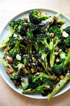 Charred — but not roasted — broccoli salad with dates, almonds and cheddar. This is such a refreshing change from roasted vegetables, and so incredibly delicious. It's a great make-ahead salad, because the broccoli remains firm even with time, and as it sits, it gets more delicious because the dates, almonds and cheddar soak up the dressing. So good. #broccoli #salad #almonds #dates #cheddar
