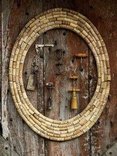 mirror, wine corks, bottle openers, cork wreath, cork boards, a frame, cork frame, bottles, cork crafts